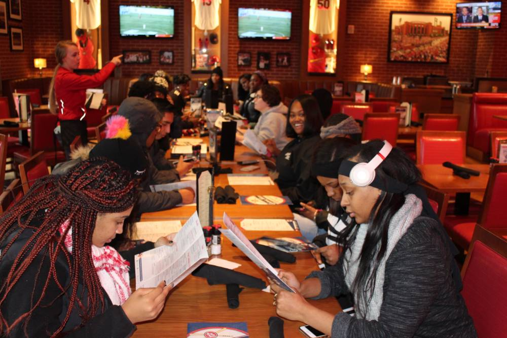 Students having dinner at a local restaurant in St. Louis
